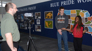 Intensive English Program coordinator David Stewart films biology major Dosia Kumbe of Nigeria and communication studies major Maxime Lechat of France as the two UIU students provide an introduction to the latest Cultural Bridge video.